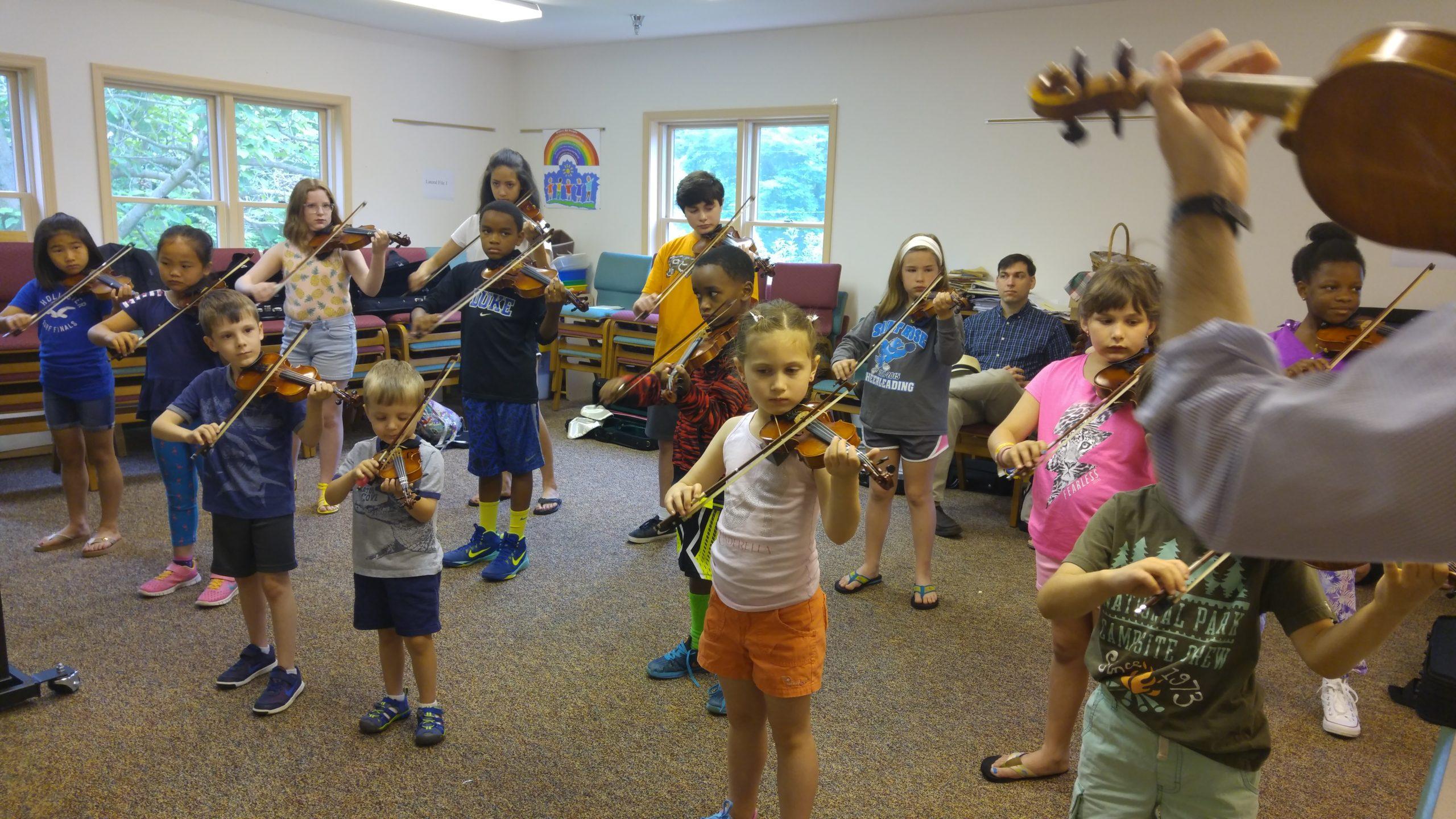 Children playing violin